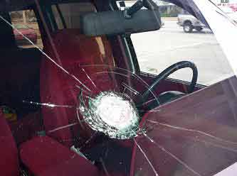 used car with cracked windshield